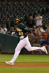 September 20, 2011; Oakland, CA, USA;  Oakland Athletics center fielder Michael Taylor (23) rounds the bases after hitting his first Major League home run against the Texas Rangers during the fifth inning at O.co Coliseum.  Texas defeated Oakland 7-2.