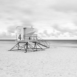 Pensacola Beach lifeguard tower four on Casino Beach. Pensacola Beach Florida is on Santa Rosa Island in the Emerald Coast area of the Southeastern United States of America. Photo is black and white and high resolution. Copyright ⓒ 2018 Paul Velgos with All Rights Reserved.