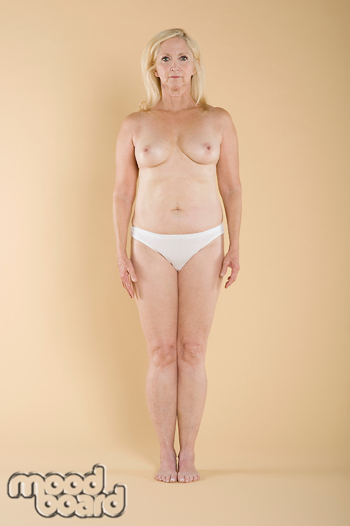 Full length of a topless woman standing