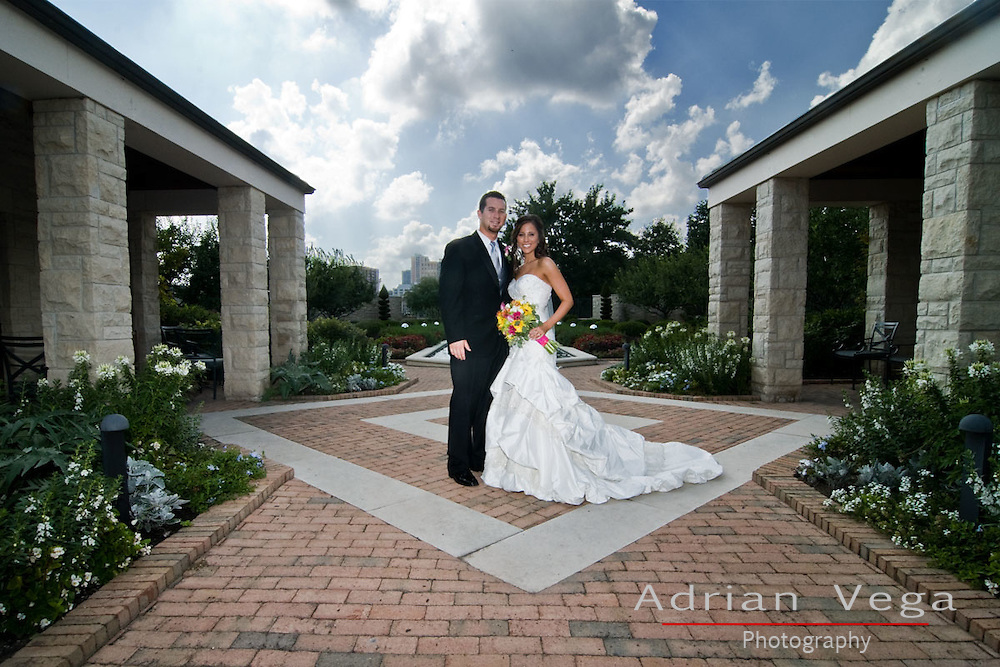 Outdoor wedding portrait with surrounding architecture