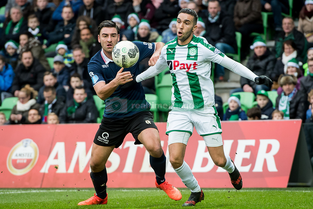 (L-R) Sander Fischer of Sparta Rotterdam, Mimoun Mahi of FC Groningen during the Dutch Eredivisie match between FC Groningen and Sparta Rotterdam at Noordlease stadium on December 24, 2017 in Groningen, The Netherlands