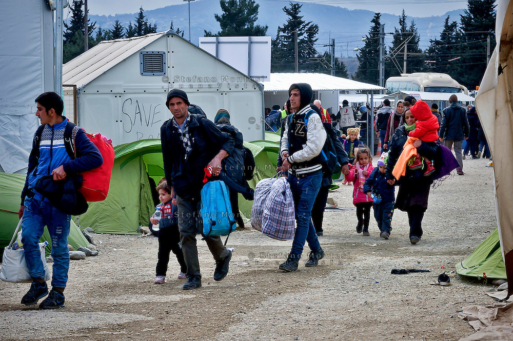 Refugees and migrants enter a refugee camp at Idomeni village, Greece, as they wait to cross the Greek-Macedonian border, 8 Febraury 2016.<br /> Hundreds of refugees arrive at Idomeni and cross the border between Greece and Macedonian on their journey to North Europe.