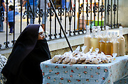 Franciscan nun selling rompopo and cookies outside El Templo de Santa María de la Asunción, Tule.