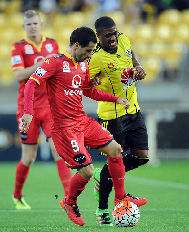 Adelaide United's Sergio Cirio, left, contests the ball with Phoenix's Rolieny Bonevacia in the A-League football match at Westpac Stadium, Wellington, New Zealand, Saturday, March 05, 2016. Credit:SNPA / Ross Setford