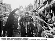 Champagne spraying after finals. Oxford. 1981. Film 8119f17<br />