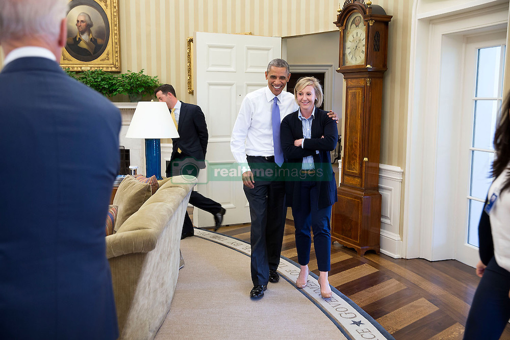 President Barack Obama greets Anita Decker Breckenridge, Deputy Chief of Staff for Operations, in the Oval Office, Oct. 17, 2014. (Official White House Photo by Pete Souza)<br /> <br /> This official White House photograph is being made available only for publication by news organizations and/or for personal use printing by the subject(s) of the photograph. The photograph may not be manipulated in any way and may not be used in commercial or political materials, advertisements, emails, products, promotions that in any way suggests approval or endorsement of the President, the First Family, or the White House.
