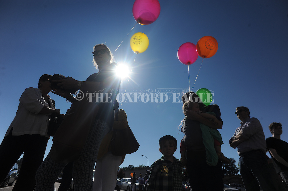 People in line for the Big Gay Ice Cream Truck hold colorful balloons, in Oxford, Miss. on Friday, October 24, 2014.