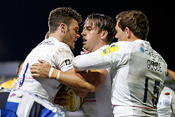 Saracens Inside Centre Chris Wyles (middle) celebrates scoring a try with teammates Duncan Taylor and Alex Goode - Photo mandatory by-line: Rogan Thomson/JMP - 07966 386802 - 03/10/2014 - SPORT - RUGBY UNION - Bath, England - The Recreation Ground - Bath Rugby v Saracens - Aviva Premiership.