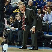 College of Charleston Head Coach Doug Wojcik yells instructions to his players in the first half of a NCAA regular season Colonial Athletic Association conference game between Delaware and The College of Charleston Wednesday, Feb 5, 2014 at The Bob Carpenter Sports Convocation Center in Newark Delaware.