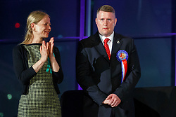 © Licensed to London News Pictures. 07/05/2016. London, UK. Green Party's SIAN BERRY and Britain First's candidate PAUL GOLDING reacting to announcement of the election results at City Hall in London on Saturday, 7 May 2016.  Labour MP Sadiq Khan has declared his victory and accused his Conservative counterpart, Zac Goldsmith MP of using underhand tactics during the campaign. Photo credit: Tolga Akmen/LNP
