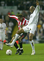 Photo. Andrew Unwin.Digitalsport<br /> Leeds United v Sunderland, Coca-Cola Championship, Elland Road, Leeds 24/09/2004.<br /> Leeds' Brian Deane (R) battles with Sunderland's Jeff Whitley (L).