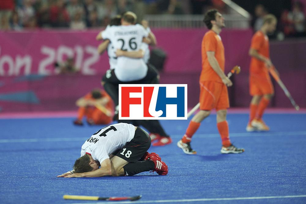 LONDON - Olympische Spelen 2012.men Final Gold.German v Netherlands.Germany wins 2-1.German men Olympic Champion .foto: Oliver Korn  kissing the ground..FFU PRESS AGENCY COPYRIGHT FRANK UIJLENBROEK.