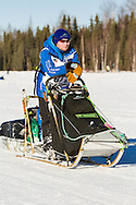 Musher Jason Mackey competing in the 44th Iditarod Trail Sled Dog Race on Long Lake after leaving the restart on Willow Lake in Southcentral Alaska.  Afternoon. Winter.