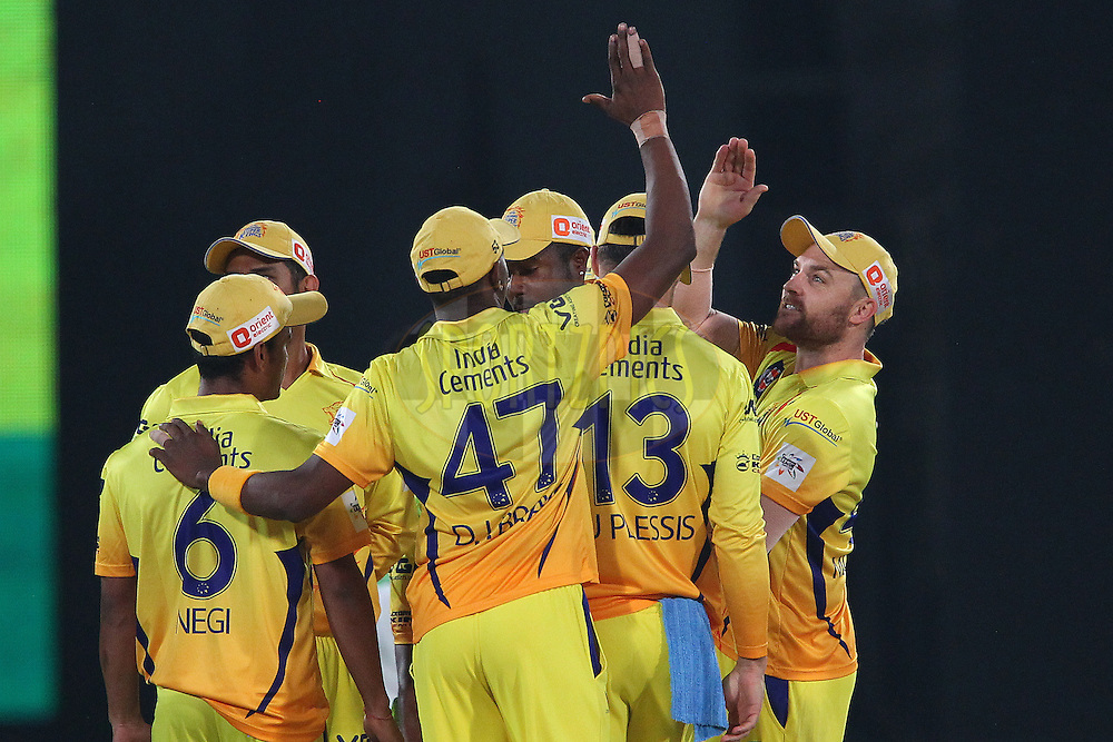 Brendon McCULLUM of the Chennai Superkings celebrates the wicket of Virender SEHWAG of the Kings XI Punjab  during the second semi final match of the Oppo Champions League Twenty20 between the Kings XI Punjab and the Chennai Superkings held at the Rajiv Gandhi Cricket Stadium, Hyderabad, India on the 2nd October 2014<br /> <br /> Photo by:  Ron Gaunt / Sportzpics/ CLT20<br /> <br /> <br /> Image use is subject to the terms and conditions as laid out by the BCCI/ CLT20.  The terms and conditions can be downloaded here:<br /> <br /> http://sportzpics.photoshelter.com/gallery/CLT20-Image-Terms-and-Conditions-2014/G0000IfNJn535VPU/C0000QhhKadWcjYs