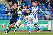 Colchester United's Sean Murray(16) Carlisle United's Luke Joyce battles for possession during the EFL Sky Bet League 2 match between Colchester United and Carlisle United at the Weston Homes Community Stadium, Colchester, England on 14 October 2017. Photo by Phil Chaplin