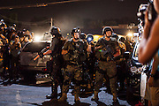 SWAT members perform an extraction of a protestor from among the journalists in the media area during continued protests in Ferguson, Mo. on August 19th, 2014. (Samuel Corum/Legion Photo)