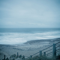 Stormy rough seascape with steps down to beach