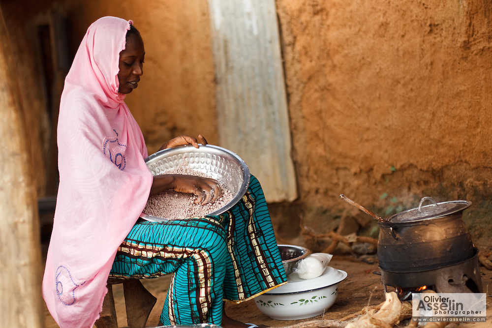 A woman sorts dried baobab fruit pulp in the village of Ambidedi Poste, Mali on Friday September 3, 2010.