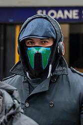 © Licensed to London News Pictures. 11/03/2020. London, UK. A tube traveller in a masks leaves Sloane St tube on the King's Road in Chelsea as Health Minister Nadine Dorries goes in to self-isolation after catching Covid19. Yesterday British Airways cancelled all flights to and from Italy as fears over the Coronavirus disease continues. Photo credit: Alex Lentati/LNP