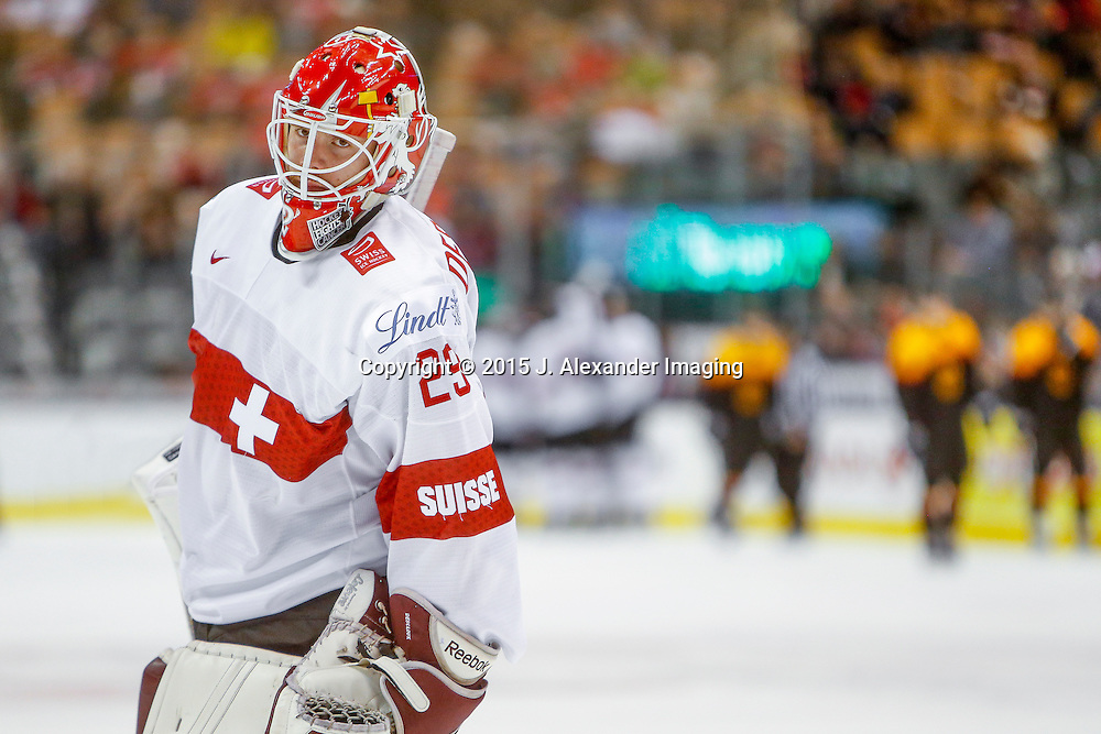 Team Switzerland goalie looks on against Team Germany during the 2015 IIHF Junior World Championships.