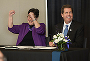 Gonzaga President Thayne McCulloh and University of Washington President Ana Mari Cauce celebrate after signing a new partnership agreement for medical education and research between the two schools. (Photo by Rajah Bose)