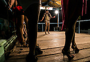 Transgenders perform fashion show during folkfore perfomance in Mojokerto, East Java, Indonesia. The group has improvised dealing with the modernity to survive.