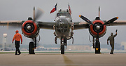 Three North American B-25 Mitchell bombers of the Commemorative Air Force were viewed by military families at Kelly Field, Lackland Air Force Base, TX on April 20, 2007. After the viewing, the three bombers made a 3-ship formation flyby of the Basic Military Training airmen graduation ceremonies. the aircraft were at Lackland Air Force Base to commemorate the 65th anniversary of the Doolittle air raid of Tokyo, Japan, the surviving airmen were present for a reunion during the week. (Photo copyright 2007 Lance Cheung)..
