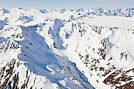 Even though it is spring it is still a winter landscape among the icecaps and glaciers of the Chugach Mountains in Chugach State Park near Anchorage in Southcentral Alaska. Morning.