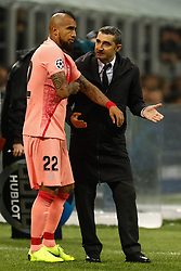 November 7, 2018 - Milan, Italy - Barcelona head coach Ernesto Valverde (R) talks to Arturo Vidal during the Group B match of the UEFA Champions League between FC Internazionale and FC Barcelona on November 6, 2018 at San Siro Stadium in Milan, Italy. (Credit Image: © Mike Kireev/NurPhoto via ZUMA Press)