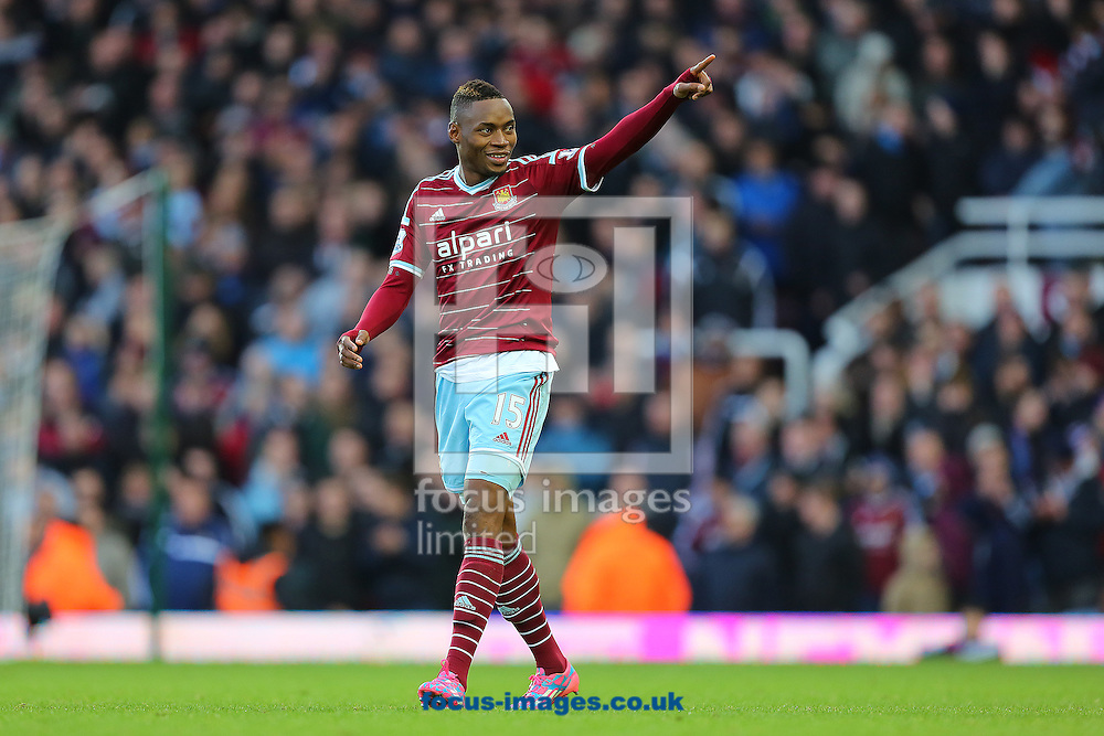 Diafra Sakho of West Ham United celebrates after scoring his sides third goal to make the score 3-1 during the Barclays Premier League match against Swansea City at the Boleyn Ground, London<br /> Picture by Richard Calver/Focus Images Ltd +447792 981244<br /> 07/12/2014