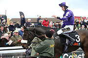 LADY BUTTONS ridden by Adam Nicol and trained by Phil Kirby enter the Winners Enclosure after winning The Listed (Class 1) OLBG.com Mares Hurdle Race (NHMOPS Bonus Race) over 2m (£22,000)  during the Bet365 Meeting at Wetherby Racecourse, Wetherby, United Kingdom on 3 November 2018. Picture by Mick Atkins.