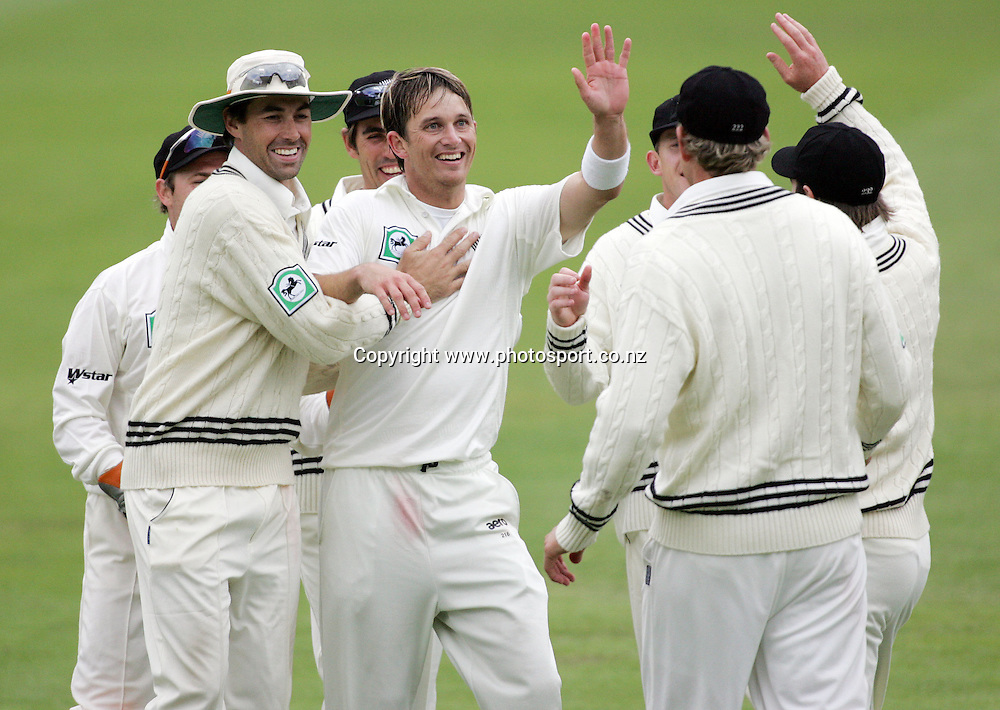 Shane Bond celebrates after claiming the wicket of Chamara Kapugedera caught by Jacob Oram for 1 run on day two of the first cricket test match between the New Zealand Black Caps and Sri Lanka at Jade Stadium, Christchurch, New Zealand on Friday 8 December 2006. New Zealand made 206 runs in their first innings. Sri Lanka are 125/8 at the end of play on day 2. Photo: Hannah Johnston/PHOTOSPORT<br /> <br /> <br /> <br /> 081206