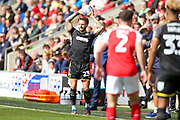 AFC Wimbledon defender Callum Kennedy (23) takes a throw in during the EFL Sky Bet League 1 match between Fleetwood Town and AFC Wimbledon at the Highbury Stadium, Fleetwood, England on 19 August 2017. Photo by Simon Davies.