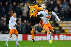 Wolves Forward Kevin Doyle (IRL) and Blackpool Midfielder Tiago Gomes (POR) compete for the ball during the first half of the match - Photo mandatory by-line: Rogan Thomson/JMP - Tel: Mobile: 07966 386802 26/01/2013 - SPORT - FOOTBALL - Molineux Stadium - Wolverhampton. Wolverhampton Wonderers v Blackpool - npower Championship.