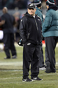 Philadelphia Eagles head coach Chip Kelly watches pregame warmups before the NFL NFC Wild Card football game against the New Orleans Saints on Saturday, Jan. 4, 2014 in Philadelphia. The Saints won the game 26-24. ©Paul Anthony Spinelli