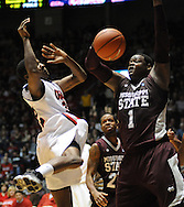 "Mississippi State's Renardo Sidney (1) blocks a shot by Mississippi's Jarvis Summers(32) at the C.M. ""Tad"" Smith Coliseum in Oxford, Miss. on Wednesday, January 18, 2012. (AP Photo/Oxford Eagle, Bruce Newman)."