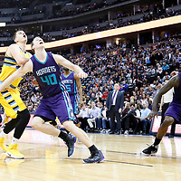 04 March 2017: Charlotte Hornets center Cody Zeller (40) vies for the rebound with Denver Nuggets forward Nikola Jokic (15) as Charlotte Hornets forward Marvin Williams (2) vies for the rebound with Denver Nuggets forward Wilson Chandler (21) during the Charlotte Hornets 112-102 victory over the Denver Nuggets, at the Pepsi Center, Denver, Colorado, USA.