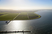Nederland, Flevoland, Gemeente Almere, 24-10-2013; Almere-Pampus, Kustzone Almere. Zicht op Muiderhoek, locatie voor een mogelijke IJmeerverbinding (IJmeerlijn). Foto richting Almere-Stad en Gooimeer. Pampushaven in de voorgrond.<br /> Windmills along the coast in Almere Poort, viewed in direction Almere-Stad.<br /> luchtfoto (toeslag op standaard tarieven);<br /> aerial photo (additional fee required);<br /> copyright foto/photo Siebe Swart.