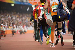 "Competitors in the women's F42 Long Jump make their way into the stadium during the Beijing 2008 Paralympic Games; National ""Bird's Nest"" Stadium, Beijing Olympic Green, China, 8th September 2008;"