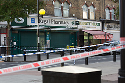 © Licensed to London News Pictures. 27/09/2015. London, UK. Police  cordon outside Regal Pharmacy on Chatsworth Road. Police have launched a murder investigation after a man was shot dead in the street outside Regal Pharmacy next to Mighty Meats butcher shop in Chatsworth Road, Hackney, east London yesterday. Photo credit : Vickie Flores/LNP
