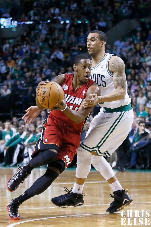 18 March 2013: Miami Heat point guard Mario Chalmers (15) drives past Boston Celtics shooting guard Courtney Lee (11) during the Miami Heat 105-103 victory over the Boston Celtics at the TD Garden, Boston, Massachusetts, USA.