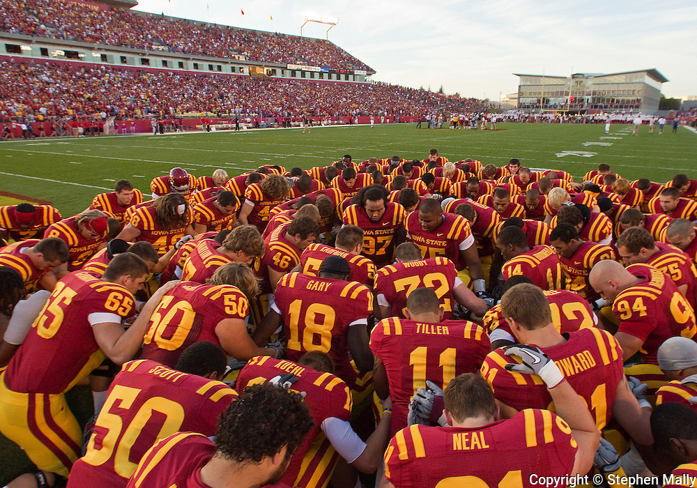 October 9 2010: Iowa State players pray before the first half of the NCAA football game between the Utah Utes and the Iowa State Cyclones at Jack Trice Stadium in Ames, Iowa on Saturday October 9, 2010. Utah defeated Iowa State 68-27.
