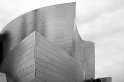 The curved stainless-steel exterior of the Walt Disney Concert Hall located in downtown Los Angeles was designed by architect Frank Gehry. The Disney Concert Hall, opened in 2003