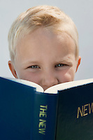 Boy Reading The New Testament