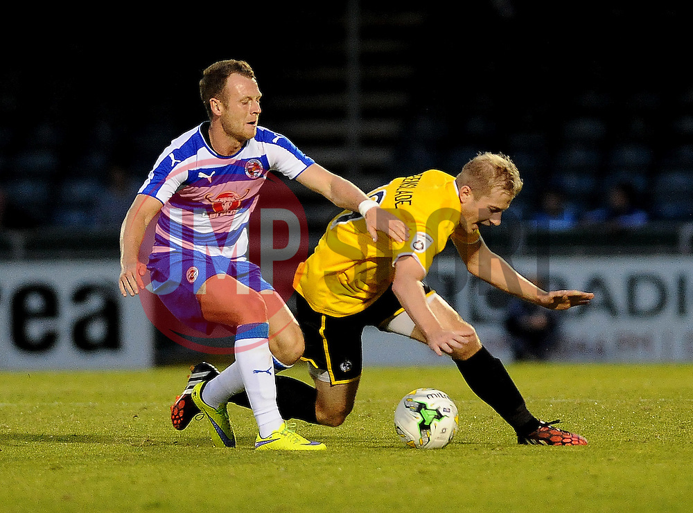 Danny Greenslade of Bristol Rovers is challenged by Reading's Jake Taylor - Mandatory by-line: Neil Brookman/JMP - 21/07/2015 - SPORT - FOOTBALL - Bristol,England - Memorial Stadium - Bristol Rovers v Reading - Pre-Season Friendly