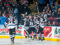 KELOWNA, CANADA - SEPTEMBER 25: Devante Stephens #21, Dillon Dube #19, Tyson Baillie #24, Riley Stadel #3 and Cal Foote #25 celebrate the first goal of the regular season during the first period of the home opener against the Kamloops Blazers on September 25, 2015 at Prospera Place in Kelowna, British Columbia, Canada.  (Photo by Marissa Baecker/Getty Images)  *** Local Caption *** Devante Stephens; Dillon Dube; Tyson Baillie; Riley Stadel; Cal Foote;