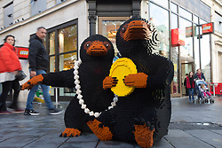 EDITORIAL USE ONLY Two LEGO brick Nifflers, which are fan-favourite creatures from the new J.K. Rowling film Fantastic Beasts: The Crimes of Grindelwald, appear in Leicester Square to celebrate a new range of Wizarding World play sets, London.