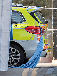 © Licensed to London News Pictures. 05/04/2018. London, UK. A  blanket hangs from a police car in Hackney where a 20 year old man was stabbed in Link Street. Police were approached by a man suffering from stab injuries at 8pm last night he was pronounced dead at 8. 24pm by officers. Photo credit: Peter Macdiarmid/LNP