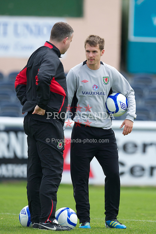 BRAY, REPUBLIC OF IRELAND - Thursday, May 26, 2011: Wales' captain Aaron Ramsey with assistant manager Raymond Verheijen during a training session at Bray Wanderers' Carlisle Grounds ahead of the Carling Nations Cup match against Northern Ireland. (Photo by David Rawcliffe/Propaganda)