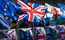 © Licensed to London News Pictures. 28/01/2019. London, UK. EU, UK, Scottish and Welsh flags flutter in Winter sunshine opposite Parliament ahead of crucial votes on Brexit amendments. Photo credit: Peter Macdiarmid/LNP